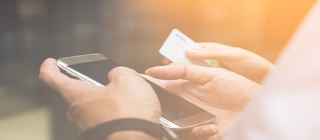 Man and woman hands using credit card for making online payment through smartphone, concept of online payment business, selective focus