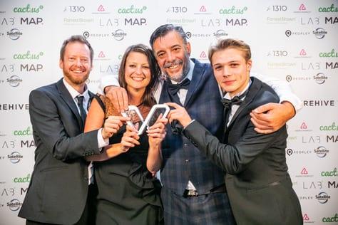 Digital Storm, award winning agency, Directors and Head of Marketing holding the award.
