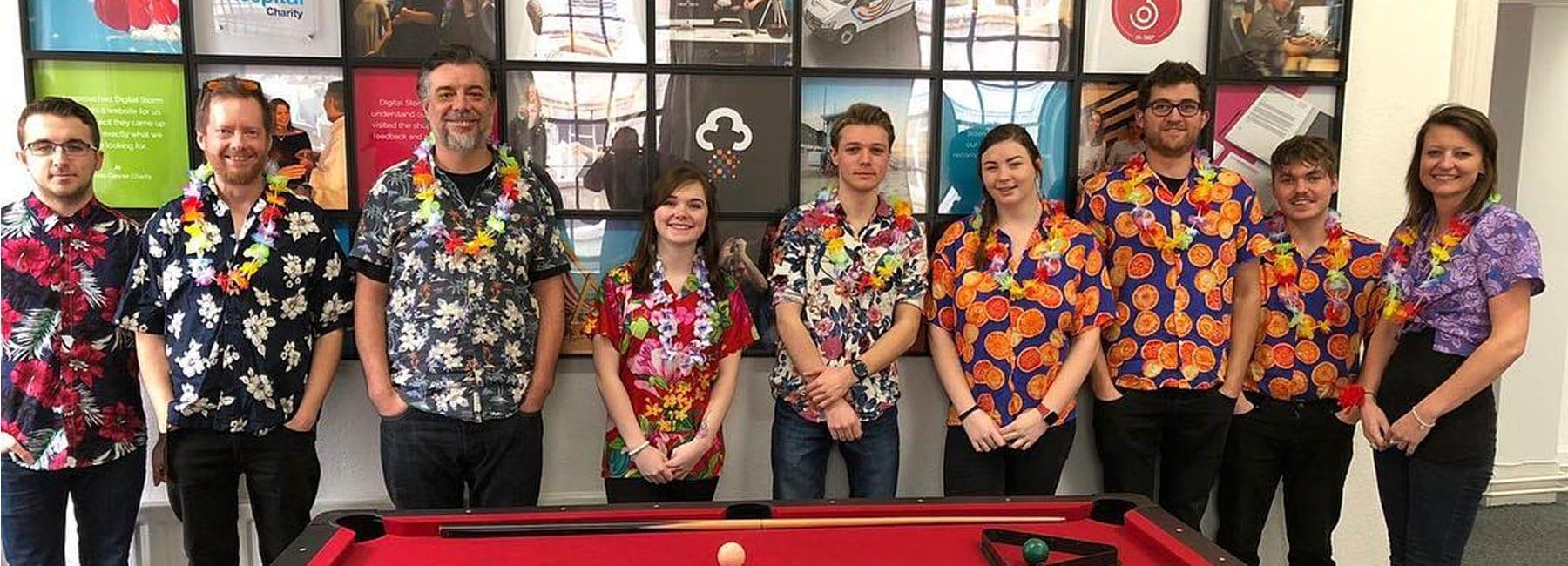 Digital Storm team sporting Hawaiian shirts
